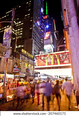 NEW YORK, USA - JUNE 28th 2014: Times Square and 42nd Street is a busy tourist intersection of neon art and commerce and is an iconic street of New York and America  - stock photo