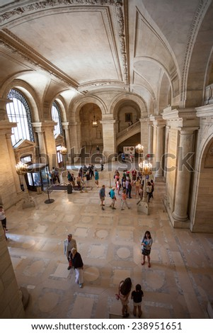New York, USA - June 9, 2014: The classical facade of the New York Public Library on Fifth Avenue at 42nd Street  - stock photo