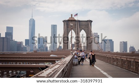NEW YORK, USA - June 10: The pedestrian walkway along The Brooklyn Bridge in New York City on June 10, 2014. Approximately 4,000 pedestrians and 3,100 cyclists cross this historic bridge each day.