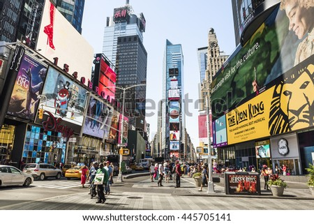 New York, USA - June 18, 2016: Times Square during the day with advertisements for the Lion King musical and stores such as Forever 21 and H&M - stock photo