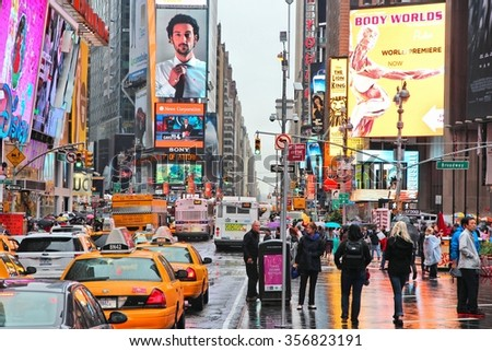 NEW YORK, USA - JUNE 10, 2013: Tourists and local people visit rainy Times Square in New York. The square at junction of Broadway and 7th Avenue has some 39 million visitors anually. - stock photo