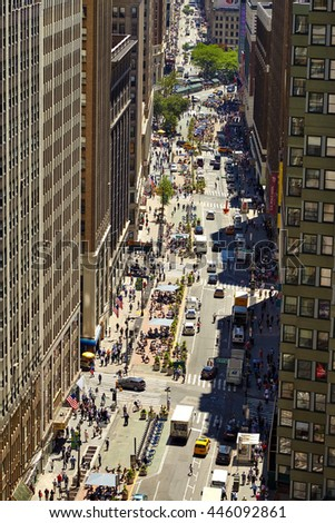 NEW YORK, USA - JUNE 14, 2016: View down a busy street