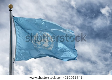 NEW YORK - USA - 11 JUNE 2015 Waving united nations UN flag in the deep blue sky background - stock photo
