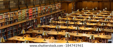 NEW YORK, USA - MARCH 14: Lights on tables and books aside in the historical Rose Main Reading Room in New York Public Library NYPL , on March 14, 2014 in New York, USA. - stock photo