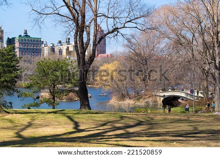 NEW YORK, USA - MARCH 26: Unknown people in the central park. The central park is one of the largest in the USA and the most known in the world on March 26, 2014 in New York, USA - stock photo