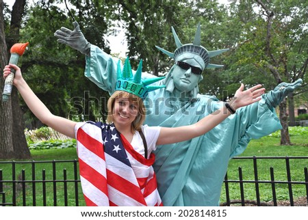 NEW YORK, USA - MAY 18: A busking mime performs in New York, The USA on May 18, 2009. Living green statue is the entertainment for the tourists. - stock photo