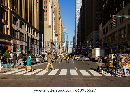 NEW YORK, USA - MAY 17, 2015: PEOPLE CROSS AVENUE ON MANHATTAN