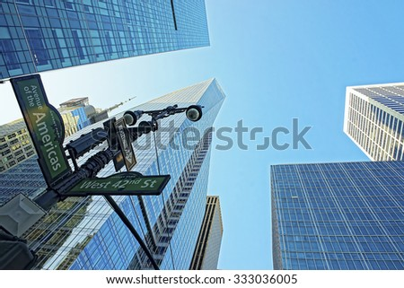NEW YORK, USA - MAY 7, 2015: Street sign on the corner of West 42nd Street and Avenue of the Americas in Manhattan, New York City, USA                    - stock photo