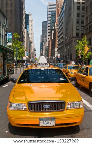 NEW YORK, USA - MAY 7: Taxis in the traffic of 5th Avenue, Manhattan, May 7th, 2013 in New York City. Fifth Avenue has the world's most expensive retail spaces as the symbol of wealthy New York. - stock photo