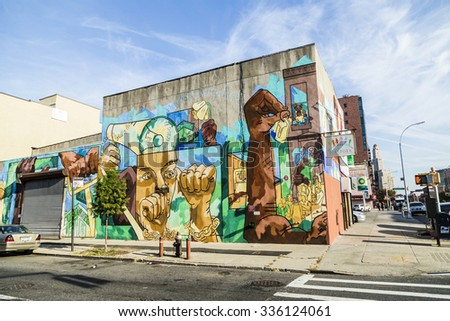 NEW YORK, USA - OCT 21 2015: colorful mural wall painting in New York. Especially in Brooklyn wall painting at the old not restored houses are usual. The murals often tell stories. - stock photo