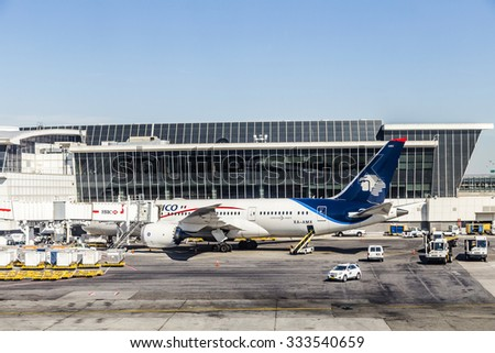 NEW YORK, USA - OCT 20, 2015: dreamliner from Aeromexico at Terminal 4 with loading equipment at JFK Airport in NY. 1963 the airport was rededicated John F. Kennedy International Airport. - stock photo