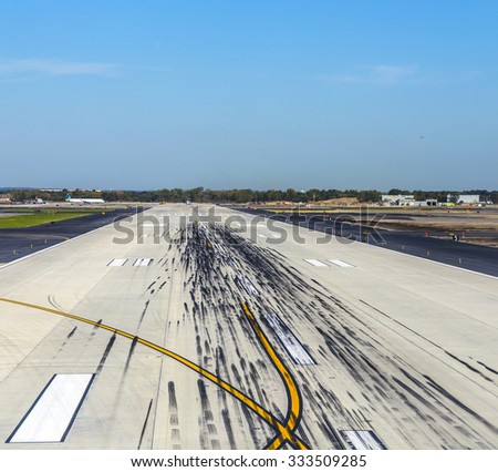 NEW YORK, USA - OCT 20, 2015: empty runway at the John F. Kennedy airport in New York. The airport was renamed in 1963 to president John F. Kennedy.
