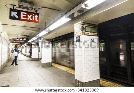 NEW YORK, USA - OCT 22, 2015: People wait at subway station 191st street in New York. With 1.75 billion annual ridership, NYC Subway is the 7th busiest metro system in the world. - stock photo