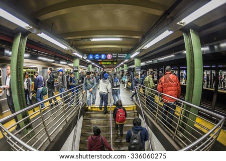 NEW YORK, USA - OCT 21 2015: People wait at subway station times square in New York. With 1.75 billion annual ridership, NYC Subway is the 7th busiest metro system in the world. - stock photo