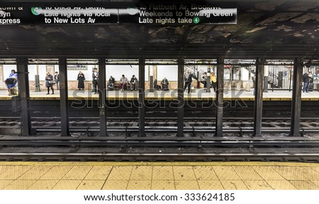 NEW YORK, USA - OCT 20, 2015: People wait at subway station Wall street in New York. With 1.75 billion annual ridership, NYC Subway is the 7th busiest metro system in the world.
