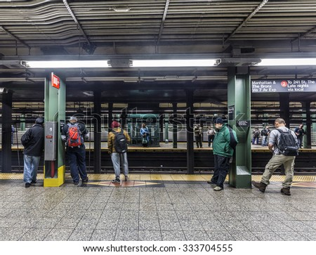 NEW YORK, USA - OCT 20, 2015: People wait at subway station Wall street in New York. With 1.75 billion annual ridership, NYC Subway is the 7th busiest metro system in the world. - stock photo