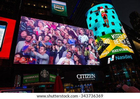 NEW YORK, USA - OCT 8, 2015: Times Square at night, a major commercial neighborhood in Midtown Manhattan, New York City - stock photo