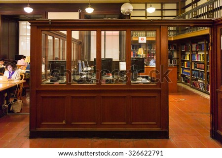 NEW YORK, USA - OCT 8, 2015: Unidentified people in the Public library on the 5th avenue,  Bryant Park, Manhattan, New York. The library was established in 1895