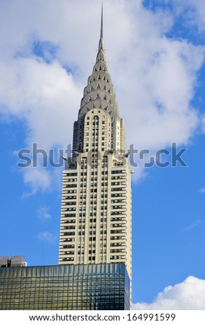 NEW YORK USA OCTOBER 27: Chrysler building facade on October 27, 2013 in New York, was the world's tallest building before it was surpassed by the Empire State Building in 1931. - stock photo