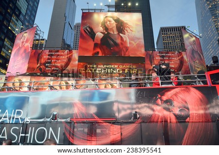 NEW YORK USA OCTOBER 27: Giant sign of The Hunger Games: Catching Fire movie in Time Square on October 27, 2013 in New York, Catching Fire, the second installment in The Hunger Games trilogy - stock photo