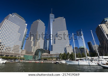 NEW YORK, USA - OCTOBER 5, 2014:Tall ships docked at the North Cove Marina at Battery Park in Manhattan and financial center panorama - stock photo