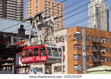 NEW YORK, USA-OCTOBER 9, 2014: The famous Roosevelt Island cable tram car that connects Roosevelt Island to Manhattan Uptown. Each cabin has a capacity up to 110 people and makes app 115 trips per day - stock photo
