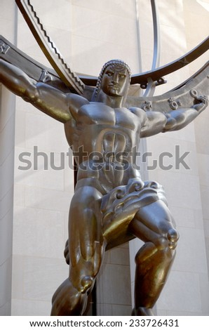 NEW YORK, USA  OCTOBER 25: The historic Atlas Statue in the Rockefeller Center stands for power in the Fifth Ave where is located the most expensive retail stores of New York city on october 25, 2013. - stock photo