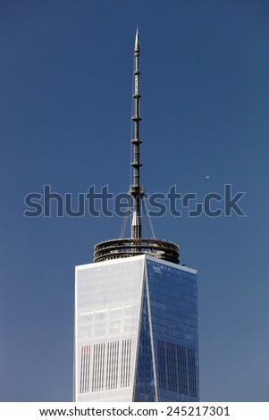 NEW YORK, USA, OCTOBER 3, 2014: The top of the Freedom Tower with 408 feet (124 m) mast containing the broadcasting antenna gave the tower symbolic height of 1,776 feet (541 m) - stock photo