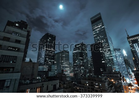NEW YORK, USA - Sep 29, 2015: Streets of Manhattan at night. Manhattan is the most densely populated of the five boroughs of New York City - stock photo