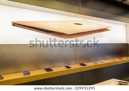 NEW YORK, USA - SEP 22, 2015: Unidentified people in the Apple store on the Fifth Avenue, New York. The store sells Macintosh personal computers, software, iPod, iPad, iPhone, Apple Watch, Apple TV