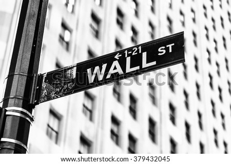 NEW YORK, USA - SEP 22, 2015: Wall Street and Broadway sign on the Lower Manhattan (Downtown). Downtown  was originated at the southern tip of Manhattan Island in 1624 - stock photo