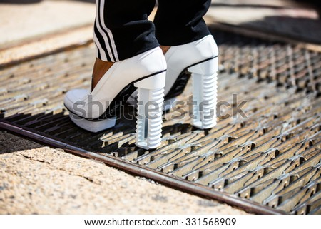 New York. Usa - September 8, 2014: Details of clothing and footwear after the Marc Jacobs show at Fashion Week in New York. Street style photo - stock photo