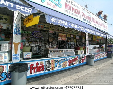 NEW YORK, USA - SEPTEMBER 2009: Snack shops on the Riegelmann Boardwalk alongside the beach in Coney Island, in the southwestern part of the borough of Brooklyn.
