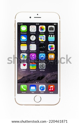 New York, USA - September 29, 2014: Studio shot of a white iPhone 6 showing the application screen with iOS8. Isolated on white. - stock photo