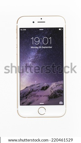 New York, USA - September 29, 2014: Studio shot of a white iPhone 6 showing the home screen with iOS8. Isolated on white. - stock photo