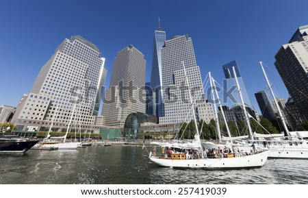 NEW YORK, USA - SEPTEMBER 27, 2014:Tall ships docked at the North Cove Marina at Battery Park in Manhattan and financial center panorama - stock photo