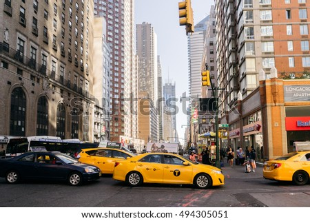 New York, USA - September 20, 2015: Yellow taxi on the street in New York.