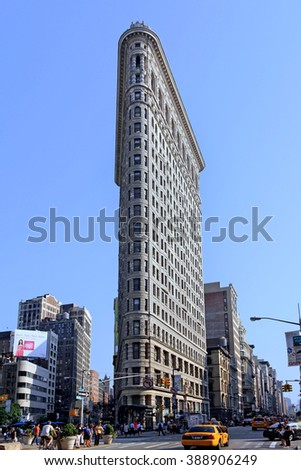 NEW YORK, USA - 2012:  The Flatiron Building, completed in 1902, is an iconic landmark in a vibrant commercial district, as seen in New York circa 2012. - stock photo