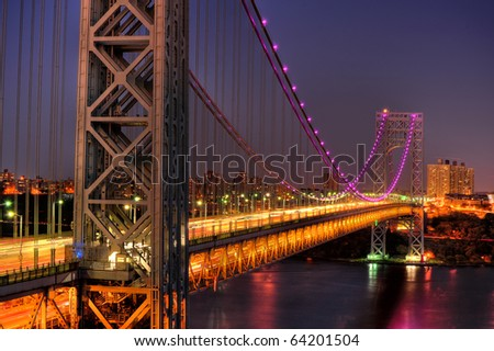 New Yorks George Washington Bridge in Pink for Breast Cancer awareness Month - stock photo