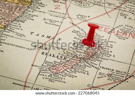 New Zealand and Tasman Sea with a pushpin on Wellington on a vintage 1920s map, selective focus (published in 1926 in New International Atlas of the World)) - stock photo