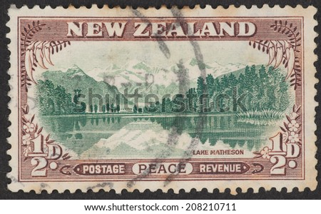 NEW ZEALAND - CIRCA 1946: A Cancelled postage stamp from New Zealand illustrating Lake Matheson, issued in 1946.