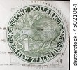 "NEW ZEALAND - CIRCA 1994: A circular stamp printed in New Zealand shows ""one dollar"", circa 1994 - stock photo"