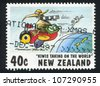 "NEW ZEALAND - CIRCA 1997: A stamp printed by New Zealand, shows Cartoonists, ""Kiwis Taking on the World"", Kiwi flying on bee, by Garrick Tremain, circa 1997 - stock photo"