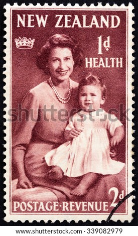 "NEW ZEALAND - CIRCA 1950: A stamp printed in New Zealand from the ""Health Stamps "" issue shows Queen Elizabeth II and Prince Charles, circa 1950. - stock photo"