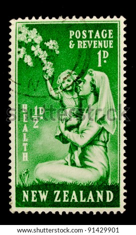 NEW ZEALAND - CIRCA 1949: A stamp printed in New Zealand shows a happy child reaching out towards a branch of apple blossom, circa 1949