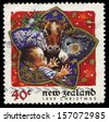 NEW ZEALAND - CIRCA 1999: A stamp printed in New Zealand, shows newborn Jesus in Manger with Animals, circa 1999 - stock photo