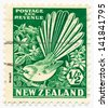 NEW ZEALAND - CIRCA 1935: A stamp printed in New Zealand, shows Pied Fantail and Clematis, circa 1935 - stock photo