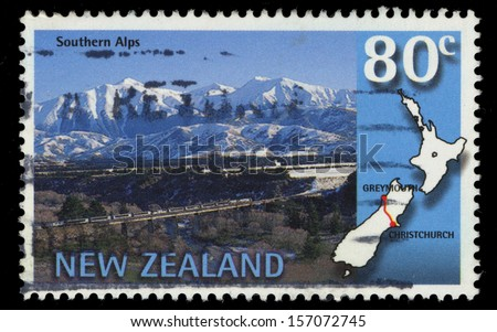 NEW ZEALAND - CIRCA 1997: A stamp printed in New Zealand shows Trans-Alpine scenic train, Southern Alps, Christchurch-Greymo uth, circa 1997 - stock photo