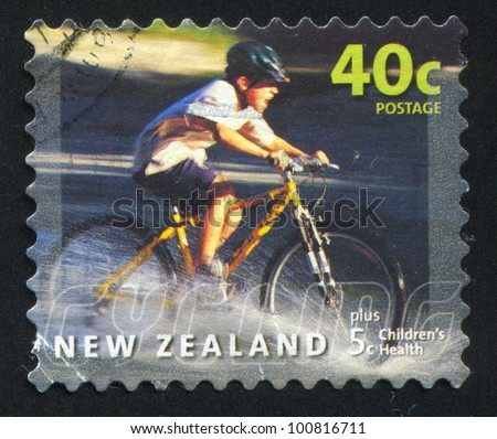 NEW ZEALAND - CIRCA 2001: stamp printed by New Zealand, shows Cyclist Riding through Puddle, circa 2001