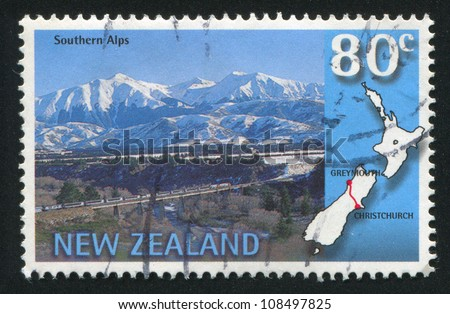 NEW ZEALAND - CIRCA 1997: stamp printed by New Zealand, shows Trans-Alpine scenic train, Southern Alps, Christchurch-Greymouth, circa 1997 - stock photo